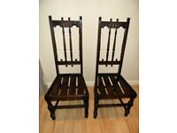 A pair of Ercol Colonial Chairs