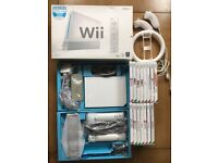 Used Nintendo Wii, 2 Controllers, 2 Nunchucks, Steering Wheel, 14 Games