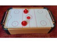 Mini air hockey table top game.