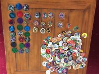COLLECTION OF POGS AND SLAMERS.
