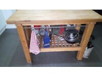 Solid wood. Butchers block/island with hanging rails.