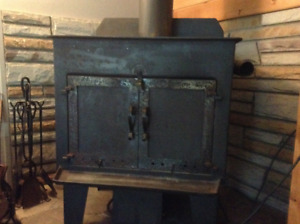 Wood stove with fan