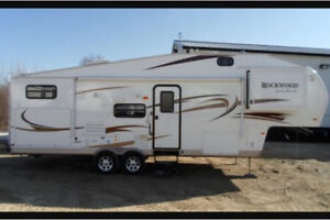 31' Forest River 5th Wheel with bunkhouse and outdoor kitchen.