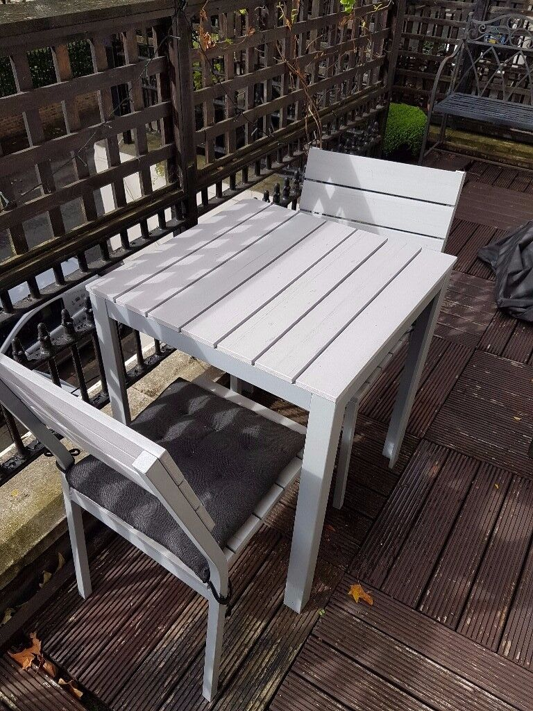 Gray patio table and two chairs w rain cover and cushions falster ikea camden