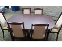Mahogany extendable dining table with 6 chairs