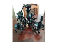 2 x black chandeliers