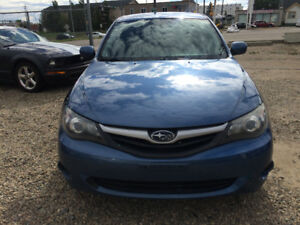 2010 SUBARU IMPREZA ALL WHEEL DRIVE, ONE YEAR WARRANTY INCLUDED!