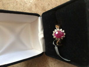 14k gold ring with large ruby surrounded by diamonds for sale