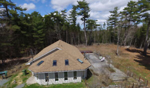 Custom Bungalow with 3.1 Acres of Land
