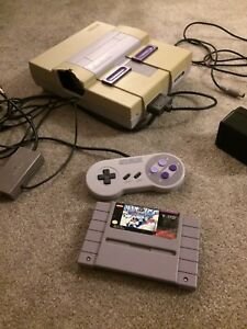 Super Nintendo with game