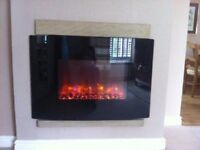 A wall mounted fire surround