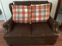 Leather 2 seater sofa chocolate brown with studding