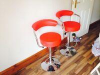 2 x modern red bar stools