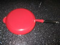 Le Creuset 26cm red cast-iron frying pan.