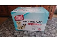 Unopened box of 100 Simple Solution puppy pads