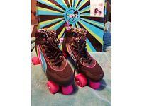 Ladies black/pink roller skates size 7