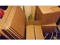 28 large cardboard packing boxes
