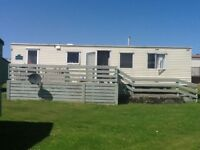 3 bedroom Cosalt Cascade 34'x10' 2008 8 berth with decking sited Three Lochs Holiday Park