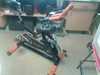 FOR SALE SHOKK REVOLVE EXCERSISE SPIN BIKE IN FULL WORKING ORDER -CAN DELIVER LOCALLY