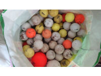 Bag of used golf balls