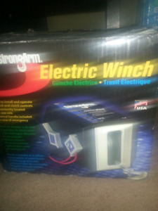 New electric 12 volt winch. $60 firm just lowered price