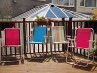A set of 4 folding chairs