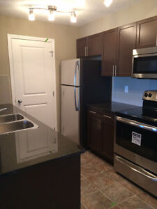 SPACIOUS 3 BED 2 BATH CONDO DOWNTOWN COCHRANE *UTILITIES INCLDED