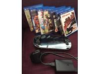 Sony PSVita, charger, sd card & 7 games
