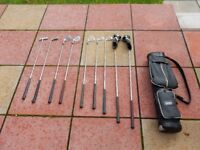 Set of eight golf clubs and shoulder bag