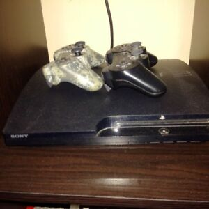ps3 with 2 remotes and 25 games