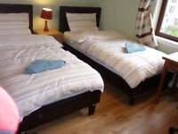 room with 2 beds for a couple or two person available for short or long term
