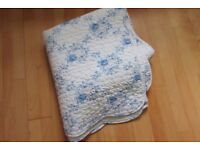 Blue and white floral bedspread