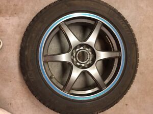 Selling rims with winter tires and stand