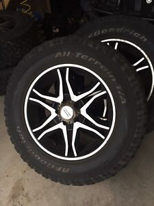 "20"" American racing rims with all terrain tires"