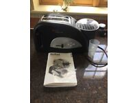 Toaster with attachment for poaching egg and heating beans