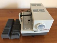 ​Vintage slide projector, slide magazines and screen for sale