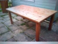 Big chunky solid pine dining table