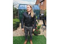 Rev'it Black leather motorcycle jacket with removable liner.