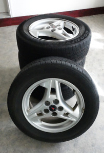 Four 15-inch alloy wheels for 2005 Pontiac Sunfire