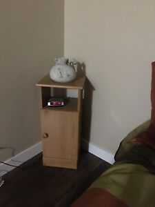 Side table or night stand with storage cupboard