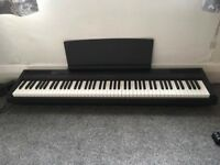 Yamaha digital piano P105 with a pedal