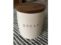 Cream ceramic bread bin with wooden lid