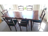 elegant dark wood extendable dining table and 6 chairs