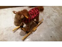 Sit on rocking horse with sound