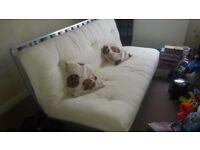 Cream futon bed settee