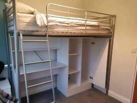 High sleeper bed frame with wardrobe and desk.