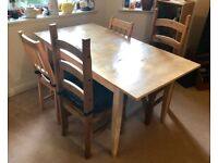 Table and mixed chairs