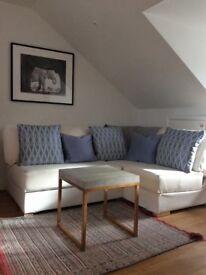 White Nabru flat pack sofa with storage, nearly new!