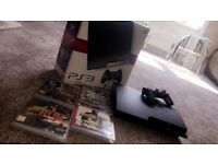 PS3 120gb, fully boxed comes with 4 games.