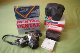 Pentax ME Super with lens, flashgun